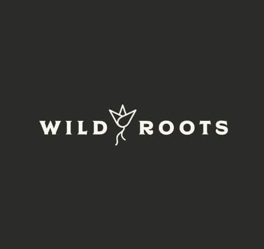black background with white wild roots word mark
