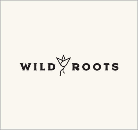 cream-colored background with black wild roots word mark