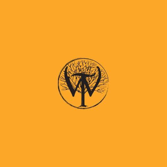 Wilderness Trail Distillery logo badge in black on gold background