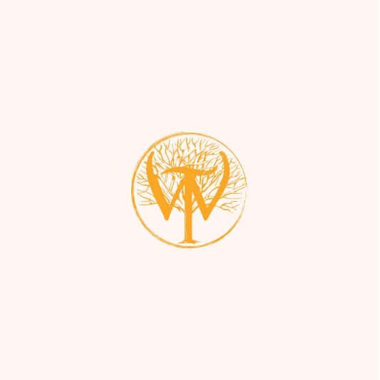 Wilderness Trail Distillery logo badge in gold on cream background