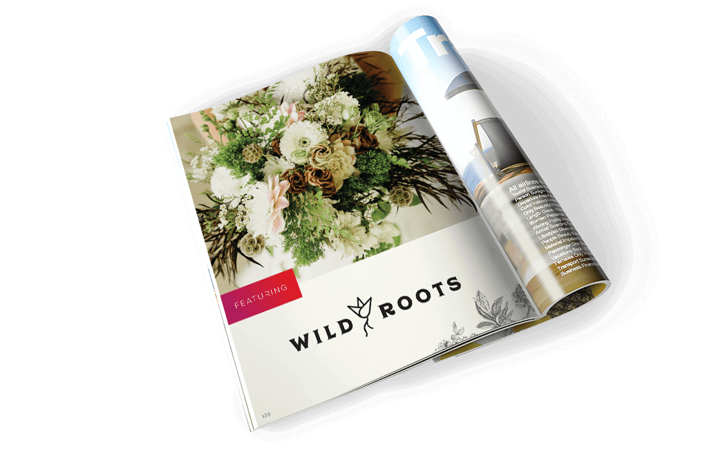 open magazine featuring wild roots word mark and picture of floral arrangement